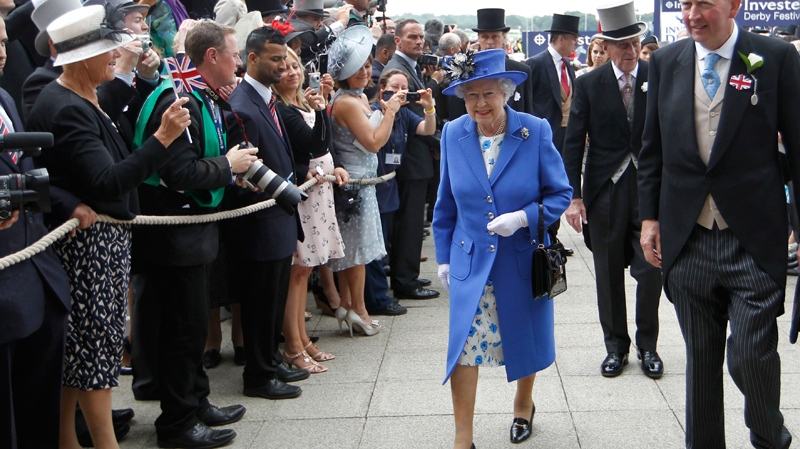 The Queen arrives for the Epsom Derby at Epsom race course, southern England at the start of a four-day Diamond Jubilee celebration to mark the 60th anniversary of the Queen's accession to the throne, Saturday, June 2, 2012. (AP / Sang Tan)