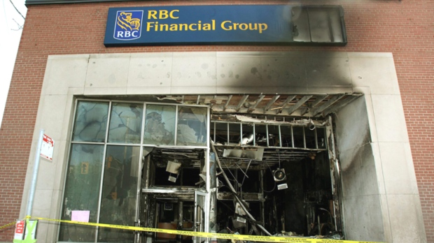 Damage is seen Wednesday, May 19, 2010 that was caused by a firebomb at an Ottawa downtown bank. (Fred Chartrand / THE CANADIAN PRESS)
