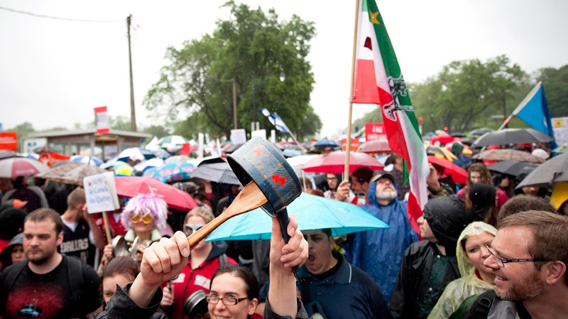 Protesters march in a slow rain through the streets of Montreal in support of the student strike and to protest against bill 78 on Saturday, June 2, 2012. (Peter McCabe / THE CANADIAN PRESS)
