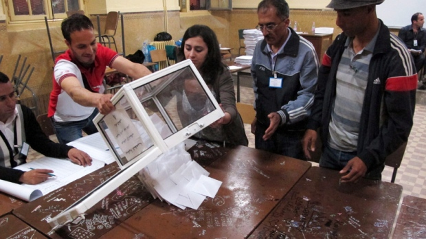 Workers at a polling station empty ballots to begin the counting process, in the Bab el-Oued neighborhood, Algiers, Thursday, May 10, 2012. (AP / Paul Schemm)