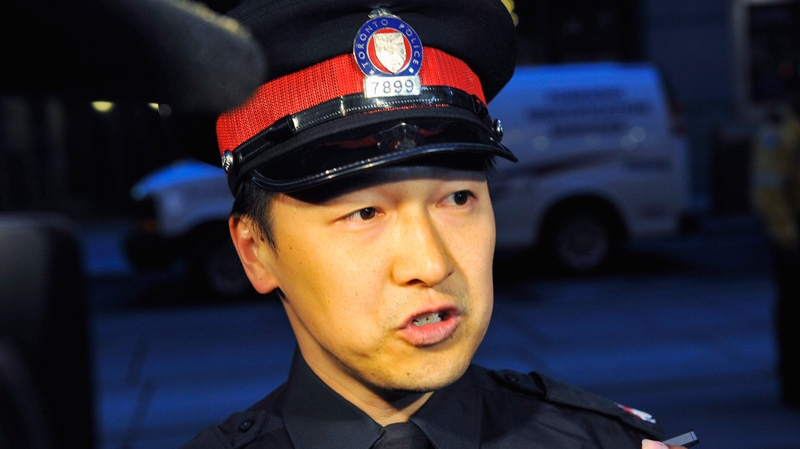 Toronto Police Const. Victor Kwong updates the media on the Eaton Centre shootings in Toronto, Saturday, June 2, 2012. (Victor Biro / THE CANADIAN PRESS)