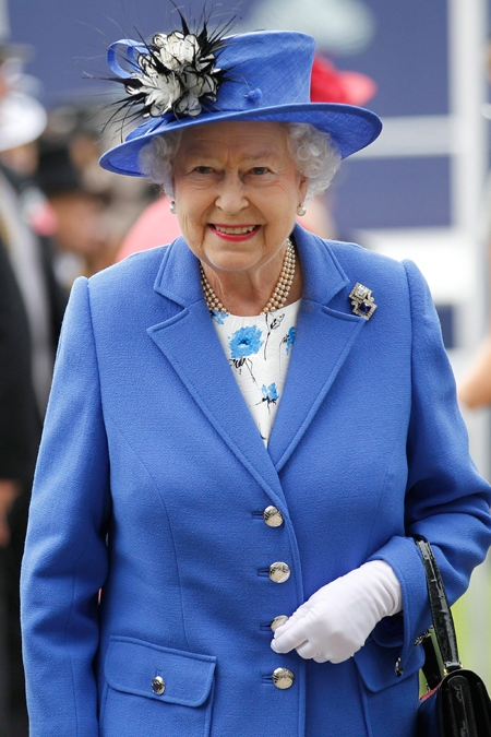 The Queen arrives for the Epsom Derby at Epsom race course, southern England at the start of a four-day Diamond Jubilee celebration to mark the 60th anniversary of the Queen's accession to the throne Saturday, June 2, 2012. (AP / Sang Tan)