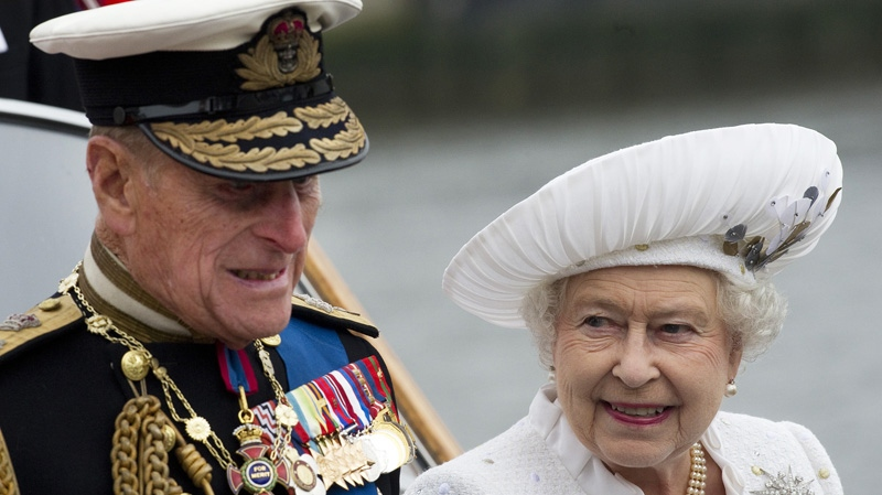 Queen Elizabeth and Prince Philip leave from Chelsea Harbour on a launch on the first part of their journey in the Diamond Jubilee River Pageant in London