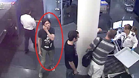 In this photo posted to Interpol's webpage for Luka Rocco Magnotta, a man appears to be at an airport security gate.