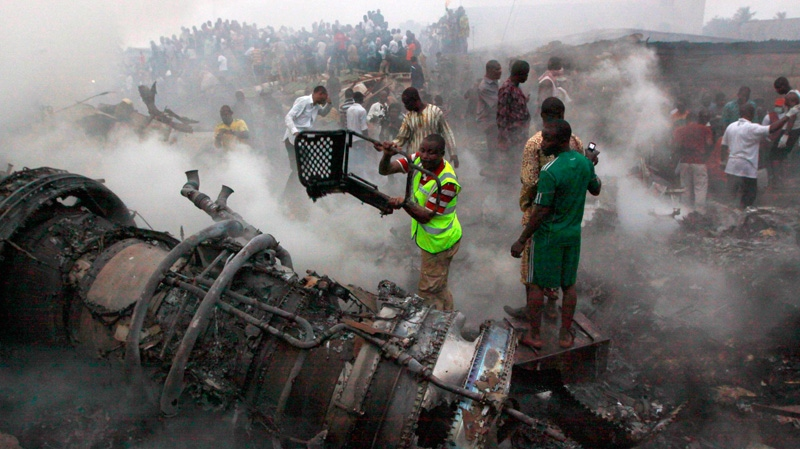 People gather at the site of a plane crash in Lagos, Nigeria, Sunday, June 3, 2012. (AP / Sunday Alamba)