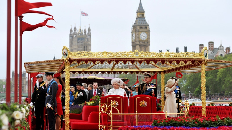 Queen Elizabeth II, centre left, and Prince Philip, centre right, with other members of the royal family watch the proceedings from on board the royal barge during the Diamond Jubilee Pageant on the River Thames in London