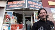 Kadir Anlayisli stands next to the internet cafe in the district of Neukoelln in Berlin, Germany, where he recognized Luka Rocco Magnotta, Monday, June 4, 2012. (AP / Markus Schreiber)