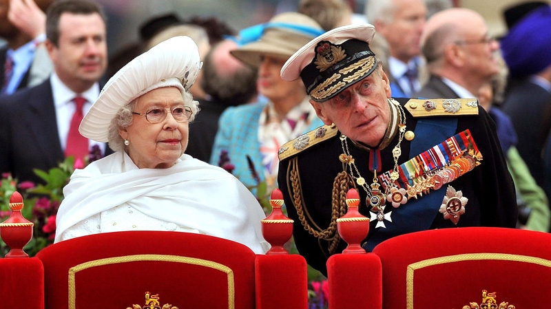 Queen Elizabeth II and her husband Prince Philip watch the proceedings from the royal barge during the Diamond Jubilee Pageant on the River Thames in London, Sunday, June 3, 2012. (AP / John Stillwell)