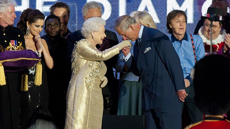 Prince Charles kisses the hand of the Queen as she is joined on stage with the rest of the royal family as well as performers at the Queen's Jubilee concert in front of Buckingham Palace, Londo