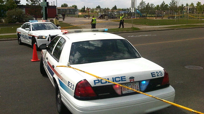 Police closed a road in front of a Mill Woods elementary school Monday afternoon as they investigate a suspicious package, just days after explosive devices were found in a field at the same school. June 4.
