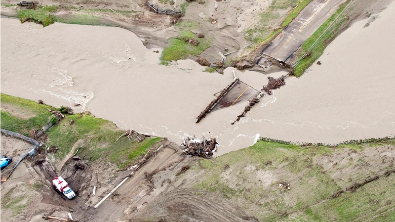 A washed out bridge on a highway near Medicine Hat, Alta., Monday, June 21, 2010. (Jeff McIntosh / THE CANADIAN PRESS)