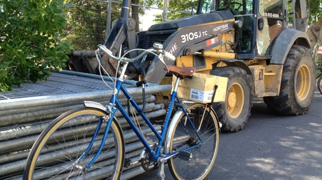 Angered resident locks bike to construction equipment in protest after trees were cut down for Lansdowne Park redevelopment Tuesday, June 5, 2012.