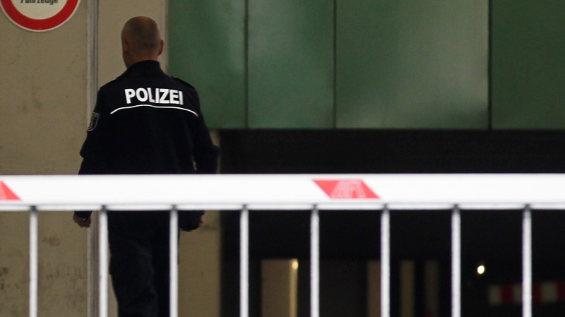 A police officer walks inside the car gateway of the central police detention facility of Berlin where Luka Rocco Magnotta is being held in Berlin, Germany, Tuesday, June 5, 2012.  (AP / Markus Schreiber)