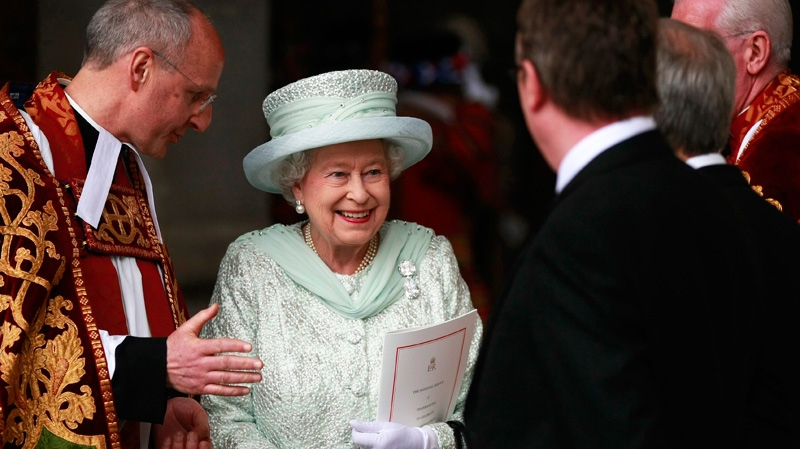 Queen Elizabeth II departs after a service of thanksgiving with the Dean of St Paul's David Ison, left, at St Paul's Cathedral, London as part of the Diamond Jubilee celebrations Tuesday June 5, 2012. (AP / Tim Hales)