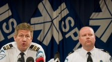 Denis Mainville, left, and Ian Lafreniere, of the Montreal police department, speak to reporters at a news conference in Montreal, Tuesday, June 5, 2012. (Graham Hughes / THE CANADIAN PRESS)