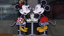 In this photo Feb. 6, 2012 file photo, the Disney Soda Fountain & Studio Store marquee is seen on Hollywood Boulevard in Los Angeles. (AP Photo/Damian Dovarganes)
