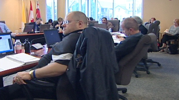 School board officials are seen discussing the budget, June 5 2012e