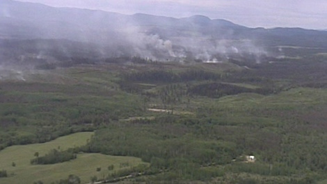 Smoke from the Greer Creek wildfire fills the air as fire crews attempt to contain the flames, June 23, 2010. (CTV)