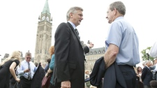 Senators, parliamentarians and their staff were evacuated from Parliament Buildings following a 5.5 magnitude earthquake in Ottawa, Wednesday, June 23, 2010. (Adrian Wyld / THE CANADIAN PRESS)