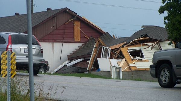 Damange to a house can be seen in Midland, Ont. after a suspected tornado tore through the area, Wednesday, June 23, 2010.