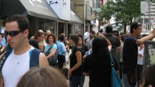 People flood into the streets at Yonge and Eglington following the earthquake in Toronto, Wednesday, June 23, 2010