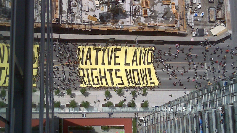 Aboriginal protesters head up Bay Street, just north of College in downtown Toronto, as seen from 41st floor of an office tower, Thursday afternoon, June 24, 2010. (Chris Saad / MyNews.CTV.ca)