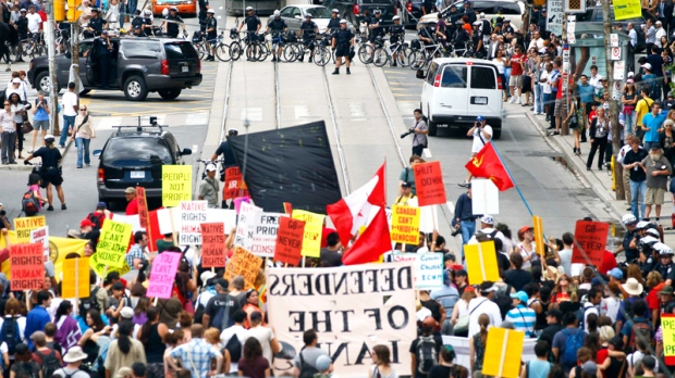 A march for Indigenous rights and against the upcoming G8 and G20 Summits, moves through the streets of Toronto, Thursday, June 24, 2010. (AP / Carolyn Kaster)