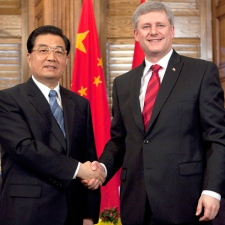Canadian Prime Minister Stephen Harper shakes hands with Chinese President Hu Jintao following a meeting on Parliament Hill in Ottawa, Thursday June 24, 2010. (Adrian Wyld / THE CANADIAN PRESS)