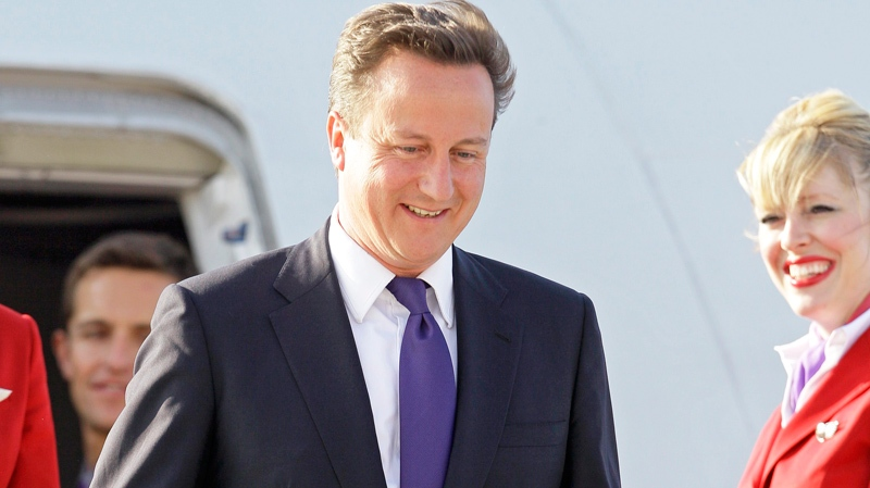 Prime Minister David Cameron of the United Kingdom arrives in advance of the G8 and G20 Summit at Pearson International Airport in Toronto, Thursday, June 24, 2010. (AP / Gerry Broome)