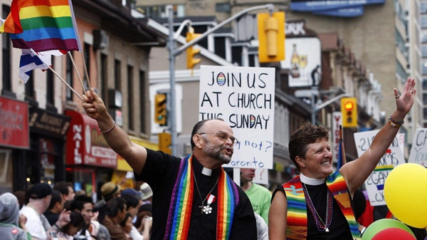 Revellers celebrate during the annual Pride Parade in Toronto on Sunday, June 28, 2009. THE CANADIAN PRESS/Nathan Denette