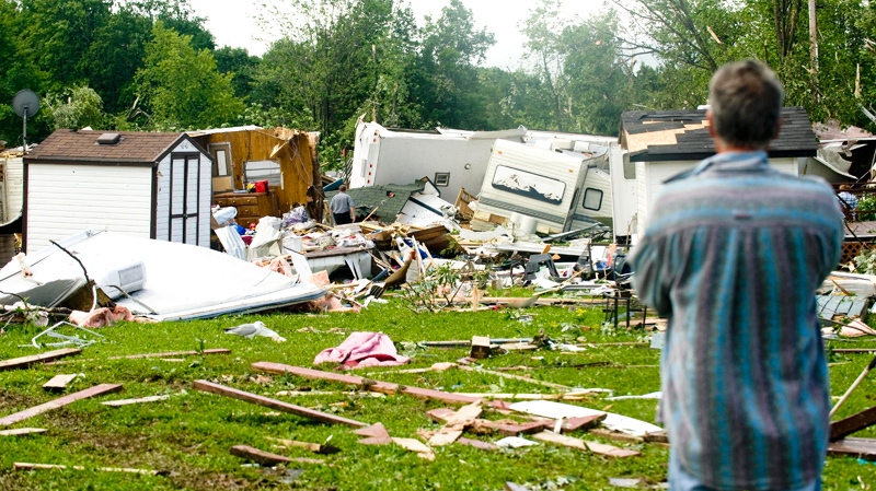 A man takes a look at the remains of destroyed trailer homes at Smiths' trailer park and camp in the town of Midland, Ontario, Thursday, June 24, 2010. (Graham Hughes / THE CANADIAN PRESS)