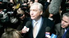 In this Dec. 10, 2007 photo, convicted newspaper baron Conrad Black leaves the federal building in Chicago. (AP / Jerry Lai)