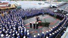 Britain's Prime Minister David Cameron, center, addresses the troops on board British Royal Navy's HMS Ark Royal carrier, in Halifax, Canada, Thursday, June 24, 2010. (AP / Lefteris Pitarakis)