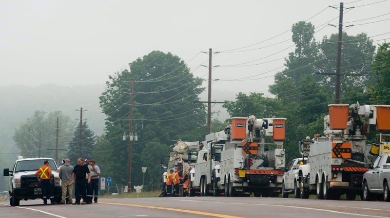 Ontario hydro maintenance crew's are shown in the town of Midland, Ontario, Thursday, June 24, 2010, following a tornado which left a number of injuries and damage to property and businesses in its wake. (Graham Hughes / THE CANADIAN PRESS)