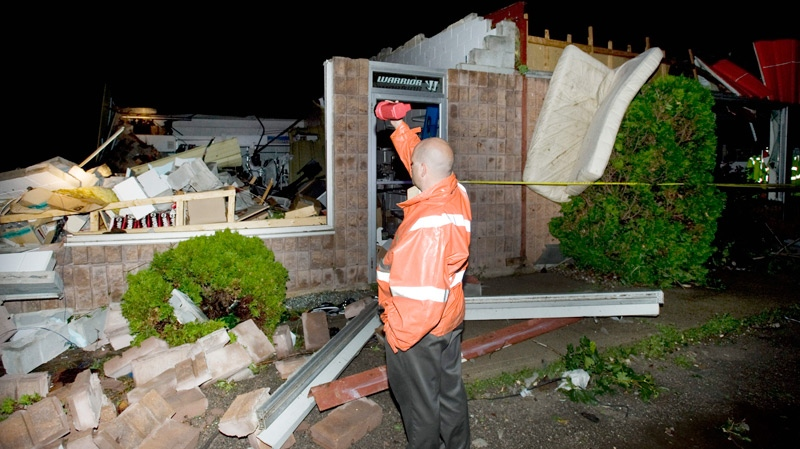 A man surveys the damage to a business following a severe storm in the town of Midland, Ont., Wednesday, June 23, 2010. (Graham Hughes / THE CANADIAN PRESS)