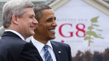 Prime Minister Stephen Harper greets U.S. President Barack Obama during the official welcoming to the G8 Summit in Huntsville, Ont., on Friday, June 25, 2010. (Sean Kilpatrick / THE CANADIAN PRESS)