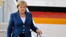 German Chancellor Angela Merkel arrives in advance of the G8 and G20 Summits at Pearson International Airport in Toronto, Thursday, June 24, 2010. (AP / Gerry Broome)
