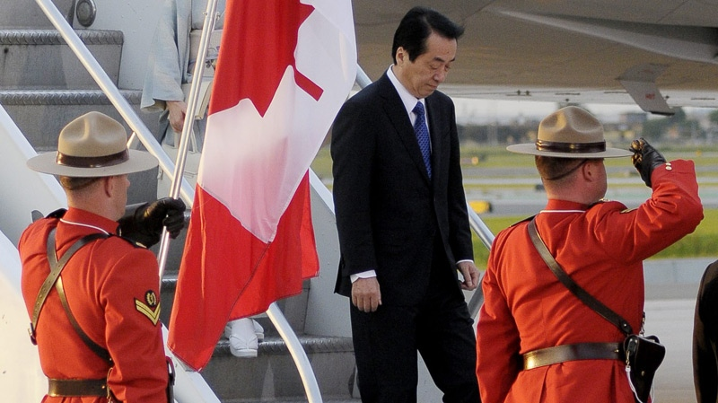 Mounties greet Japanese Prime Minister Naoto Kan as he arrives at Toronto International Airport to attend the G8 and G20 Summits in Huntsville and Toronto, Ont. on Thursday, June 24, 2010. (THE CANADIAN PRESS / J.P. Moczulski)