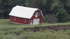 Jeff Carriere's barn slid 150 feet and was tilted askew following the quake.