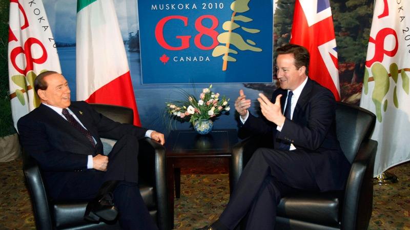 Britain's Prime Minister David Cameron, right, talks with Italy's Prime Minister Silvio Berlusconi during their meeting at the Deerhurst resort, near Huntsville, Ont., Friday, June 25, 2010. (AP / Lefteris Pitarakis)