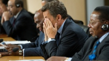 French President Nicolas Sarkozy rubs his eyes while attending the G8 Session with African Outreach Leaders, Friday, June 25, 2010, during the 2010 G8 Summit at the Deerhurst Resort, in Huntsville, Ont. (AP / Saul Loeb)