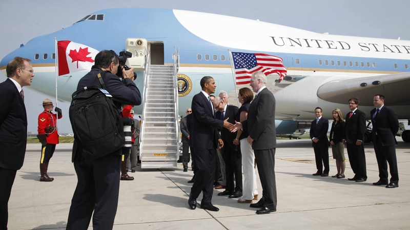 U.S. President Barack Obama greets dignitaries upon his arrival at Pearson International Airport in Toronto, Friday, June 25, 2010. (AP / Charles Dharapak)