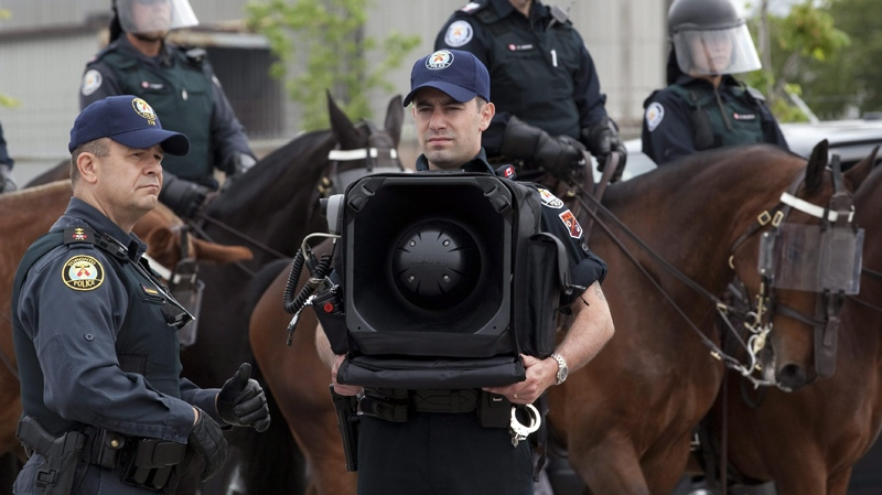A police officer stands by with and LRAD-X 100 Acoustic Communication Device (sound cannon) during a demonstration of G20 security and crowd control measures in Toronto on Thursday, June 3, 2010. (Frank Gunn / THE CANADIAN PRESS)