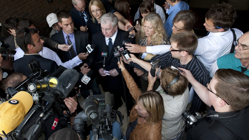 Syncrude Canada Ltd. spokesperson, Cheryl Robb, right, and lead lawyer Robert White, left, speak with reporters outside the Alberta provincial court in St. Alta., on Friday, June 25, 2010. (John Ulan / THE CANADIAN PRESS)