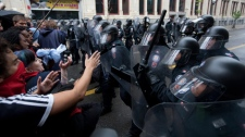 G20 summit protesters clash with riot police in downtown Toronto on Saturday, June 26, 2010. (THE CANADIAN PRESS/Darren Calabrese)