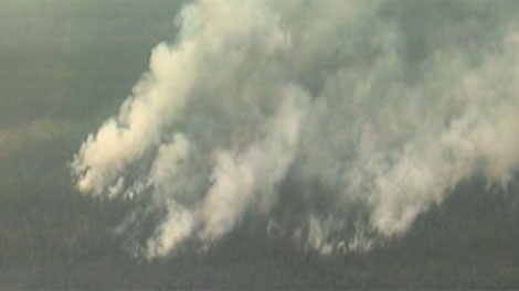 A forest fire near Cranberry Portage is spreading.