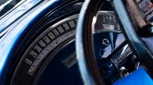A classic car speedometer.