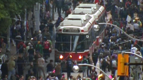 A TTC street car is blocked by a protest on Queen Street West in downtown Toronto, Saturday, June 26, 2010.