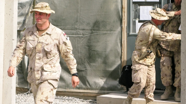 Capt. Robert Semrau (left), and his lawyers leave the military courtroom at Kandahar Airfield in this June 26, 2010 photo. (Bill Graveland / THE CANADIAN PRESS)