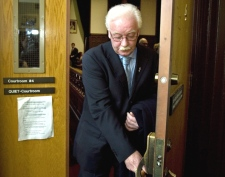 Ernie Fage, a former Nova Scotia cabinet minister, heads from court after being found guilty of failing to remain at the scene of an accident, in Halifax on Tuesday, Dec. 18, 2007. (Andrew Vaughan / THE CANADIAN PRESS)